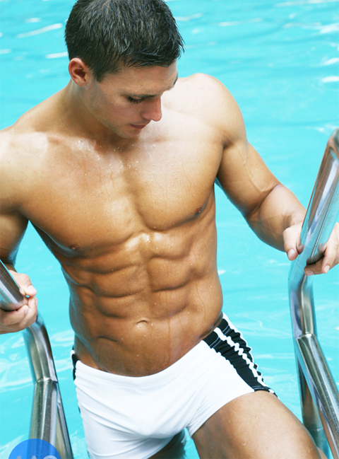 Shirtless male model coming out of the pool