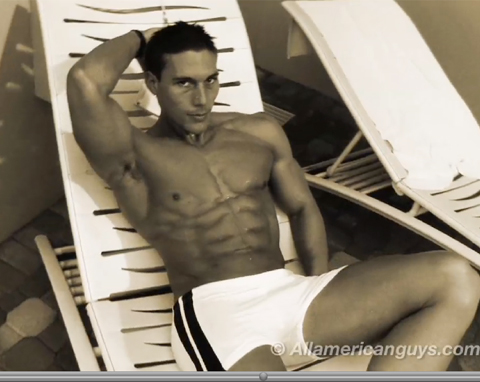 Shirtless male model sitting on deck chair