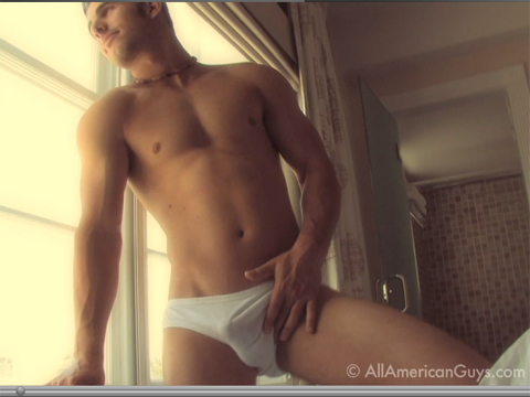 Male model posing by window