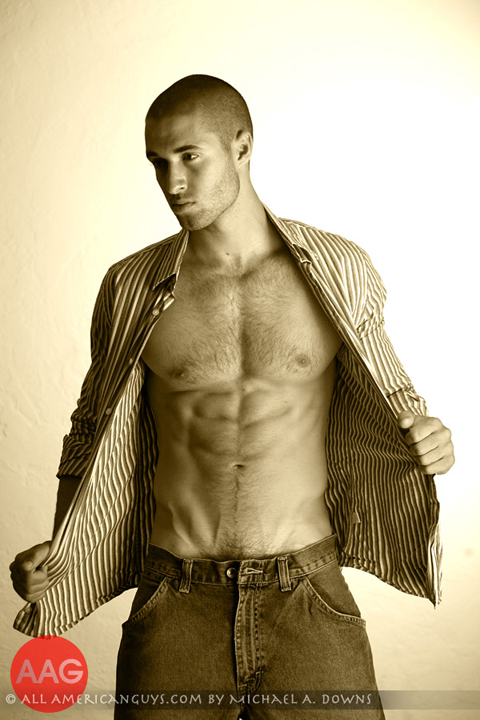 Male model taking shirt off