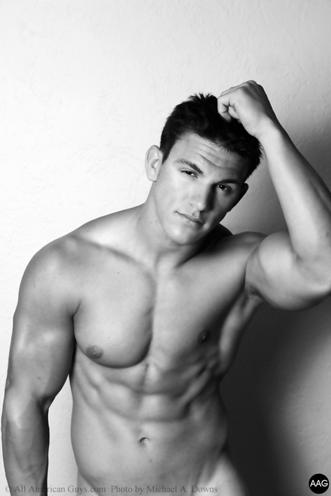 Shirtless male model standing posing