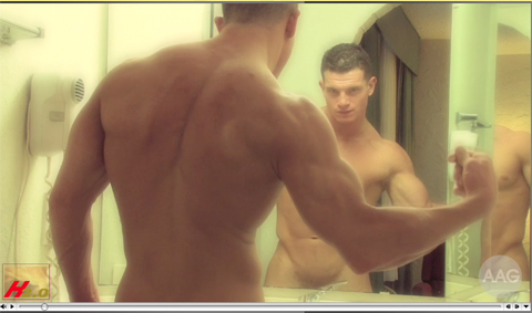 Male model flexing in the mirror