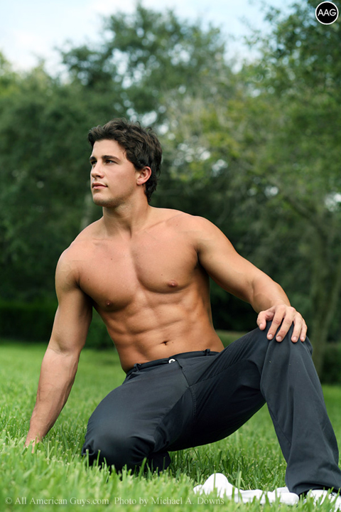 Male model posing on the grass