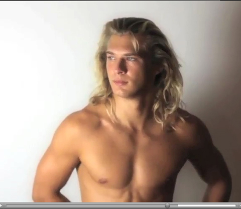 Shirtless long blond haired male model posing