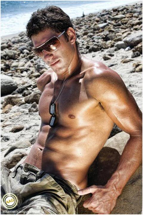 Shirtless male model posing on rocks