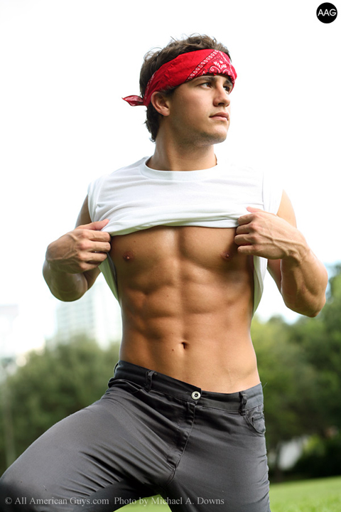 Male model about to take his shirt off
