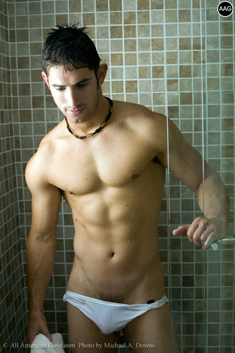 Male model coming out of the shower