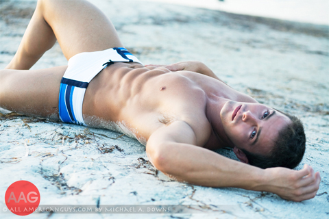 Male model posing on beach