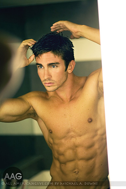Male model looking in mirror